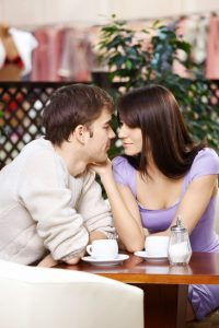 enamoured couple talking over coffee
